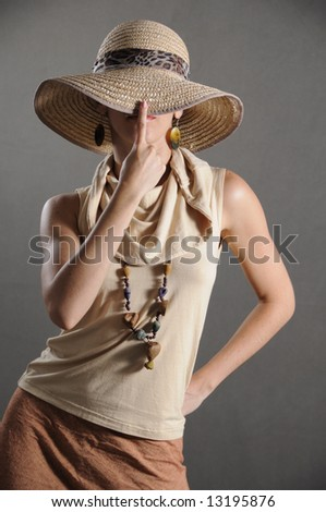 Portrait of fashion woman in retro style covering her face - stock photo