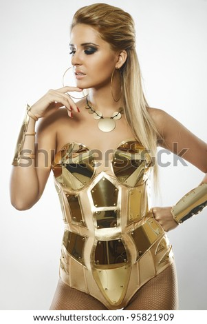 portrait of fashion woman model with beauty bright make-up and gold dress - stock photo