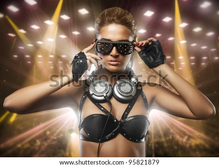 portrait of fashion woman model with glamour glasses in club - stock photo