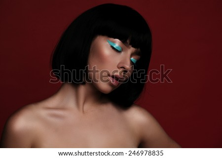portrait of fashion woman model with turquoise arrow - stock photo
