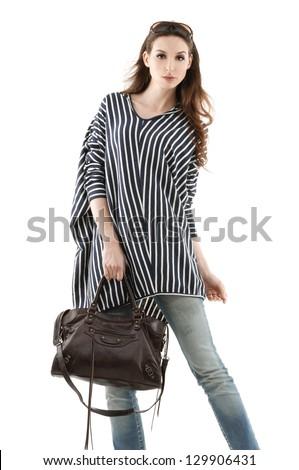 Portrait of fashion women in sunglasses with bag posing shot in studio - stock photo