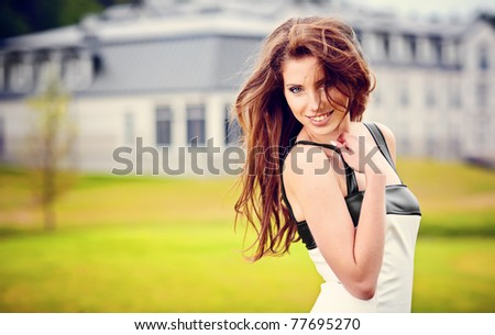 Portrait of fashion  young woman enjoying at the park - Outdoor - stock photo