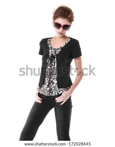 Portrait of fashion young woman wearing sunglasses standing - stock photo