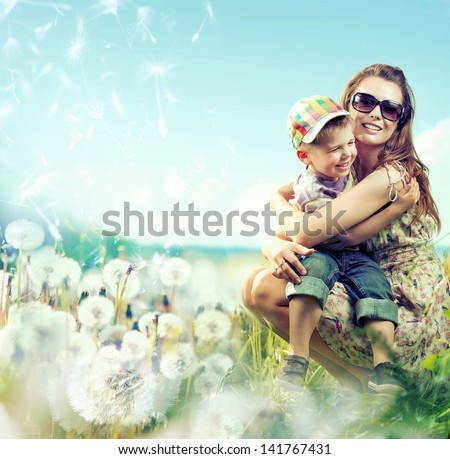 Portrait of fashionable baby boy and his mother - stock photo