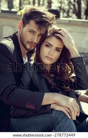 Portrait of fashionable couple - stock photo