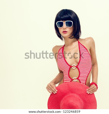 portrait of fashionable girl in a bathing suit and hat - stock photo