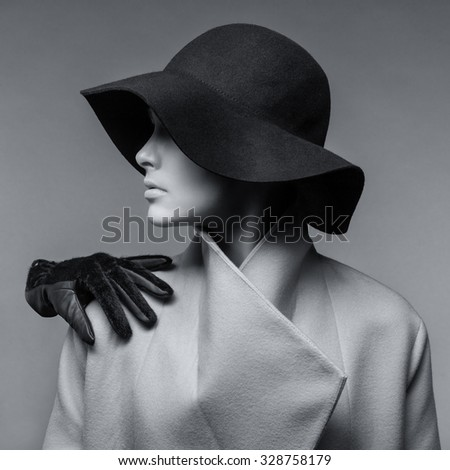 Portrait of fashionable girl in a hat and a glove on his shoulder - stock photo