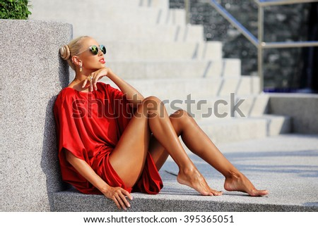 Portrait of fashionable girl in red dress - stock photo