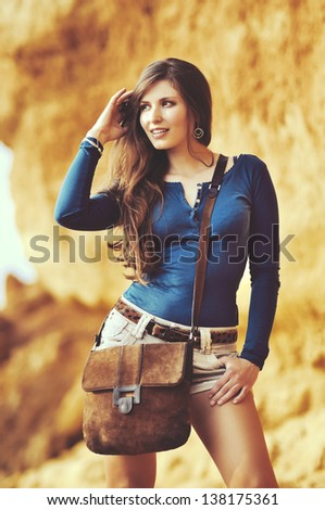 portrait of fashionable model in casual style with a leather bag - stock photo