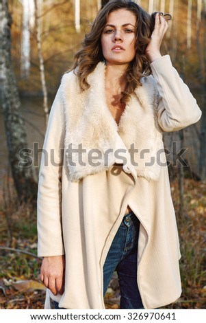 Portrait of fashionable woman in autumn park