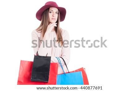 Portrait of fashionable woman with colorful shopping bags looking confident isolated on white with copyspace - stock photo