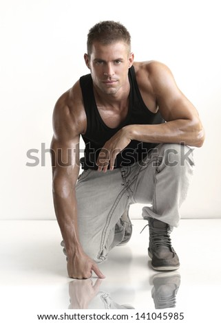 Portrait of fashionable young caucasian sexy handsome athletic man