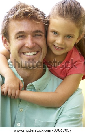 Portrait Of Father And Daughter In Park - stock photo