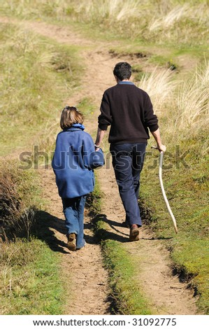 portrait of father and daughter on a walk - stock photo