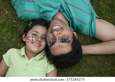 Portrait of father and daughter smiling - stock photo