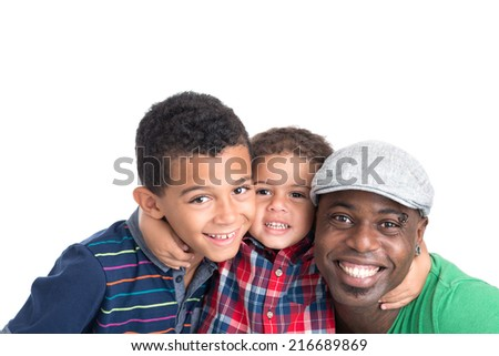 Portrait of father and his two sons looking at the camera - stock photo