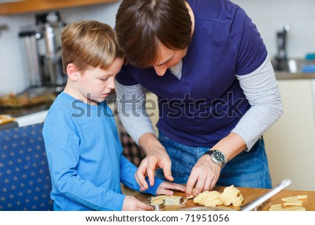 Portrait of father and son baking together