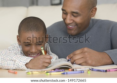 Portrait of father and son coloring