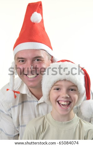 Portrait of father and son is in the caps of Santa claus