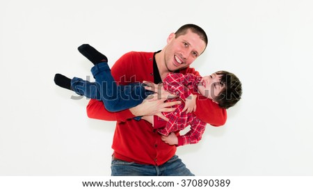 portrait of father and son playing together isolated on white background