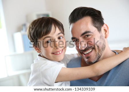 Portrait of father and son relaxing at home