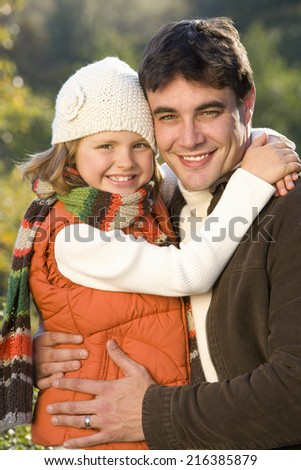Portrait of father embracing daughter, close-up