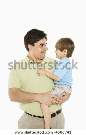Portrait of father holding son against white background.
