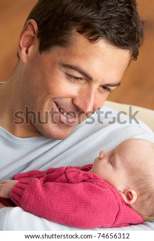 Portrait Of Father With Newborn Baby At Home - stock photo