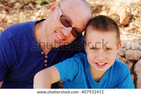 Portrait of father with son outdoors