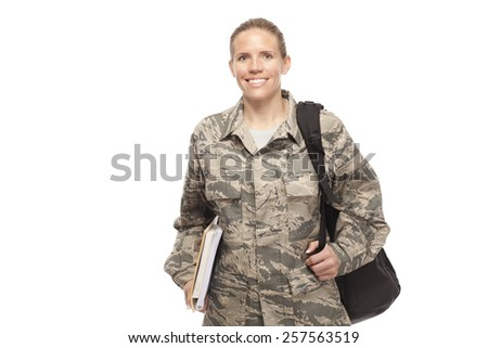 Portrait of female airman with shoulder bag and books against white background - stock photo