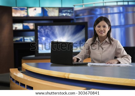 Portrait of female anchor in newsroom - stock photo