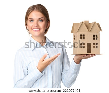 Portrait of female architect holding a little house, standing isolated on white background - stock photo