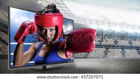 Portrait of female boxer with gloves and headgear against composite image of ring ropes - stock photo