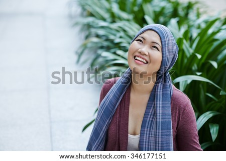Portrait of female cancer survivor in headscarf - stock photo