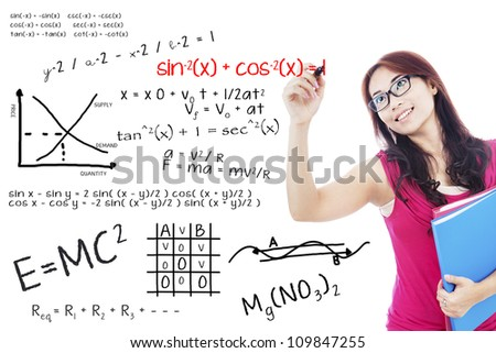Portrait of female college student using marker to write math formula on the whiteboard - stock photo