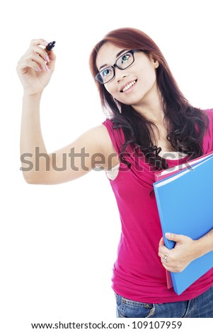 Portrait of female college student using marker to write something on a space - stock photo