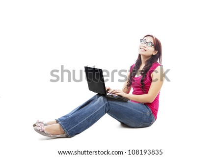 Portrait of female college student with laptop sitting on white background thinking something