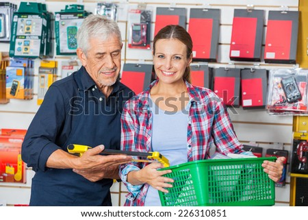 Portrait of female customer with worker in hardware shop - stock photo