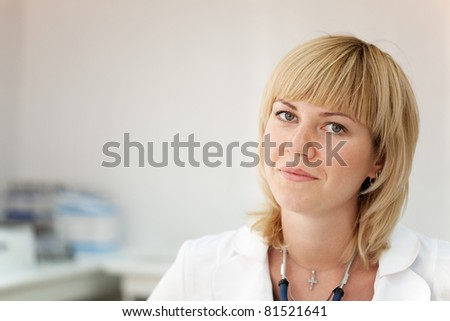 Portrait of female doctor in clinic interior - stock photo