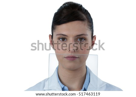 Portrait of female doctor with digital tablet against white background
