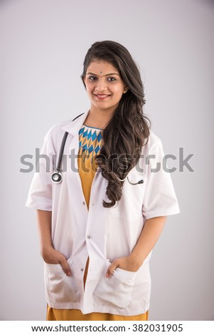 Portrait of female doctor with stethoscope around neck isolated over white background - stock photo