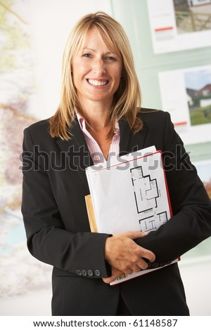 Portrait Of Female Estate Agent In Office - stock photo