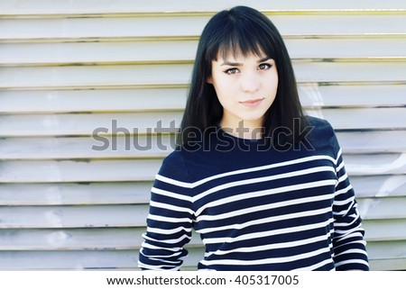 Portrait of female face with creative hairstyle. Brunette young woman face closeup. Hipster girl with fringe hairstyle.  - stock photo