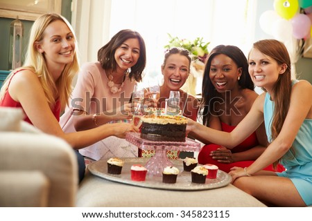Portrait Of Female Friends Celebrating Birthday At Home