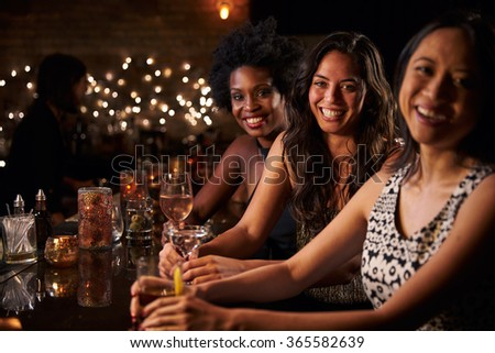 Portrait Of Female Friends On Night Out At Cocktail Bar - stock photo