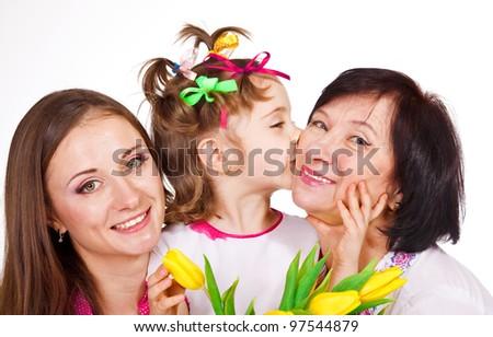 Portrait of female generation, granddaughter kissing granny - stock photo