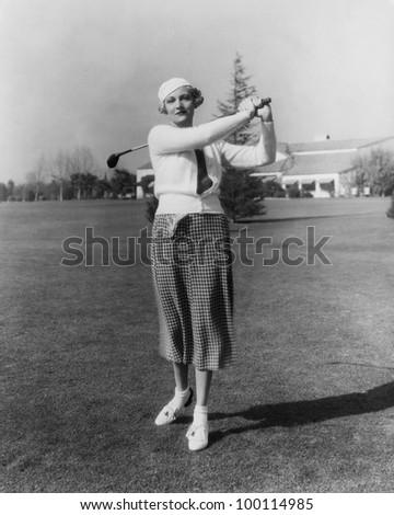 Portrait of female golfer - stock photo