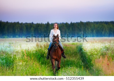 Portrait of female horse rider in foggy field
