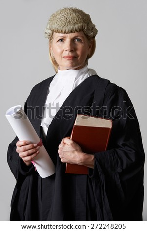 Portrait Of Female Lawyer Holding Brief And Book - stock photo