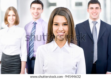 Portrait of female leader with cheerful team - stock photo